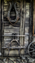 old wooden parts of wagon hanging on a wooden wall on the farm