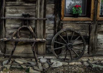 old wooden parts of wagon standing near the house at farm