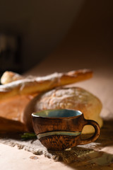 Bakery products with floured bread, loaf, baguette and a cup