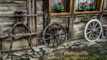 old wooden parts of wagon standing near the house