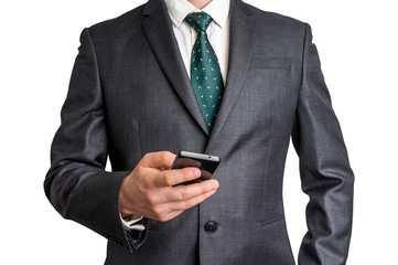 Businessman in black suit with mobile phone