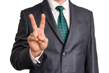 Businessman showing gesture victory with two fingers
