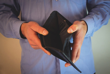 Man holding empty wallet.