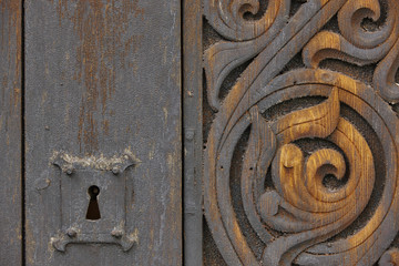 Norwegian ancient wooden carved door with lock. Heddal church.