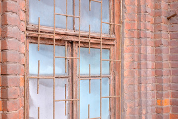 A window in an old building made of bricks