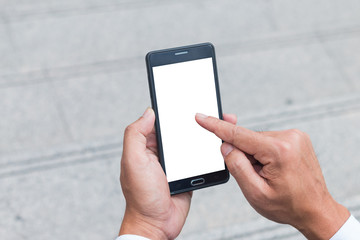 The human hands holding the smartphone and touch on mobile screen