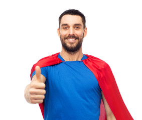 happy man in red superhero cape showing thumbs up