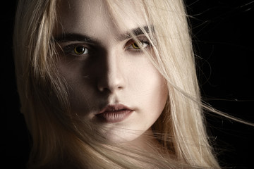 beautiful girl portrait with flying blond hair