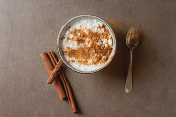 Traditional rice pudding with cinnamon. Dark background. Tasty a