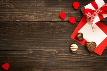 Valentine's Day background. Gift box, red hearts and Valentine's