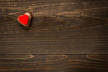 Valentine's Day heart on the wooden texture background with copy