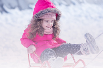 Little Cute sweet girl outdoor playing in winter snow park