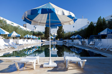 pool blue water with beach umbrella