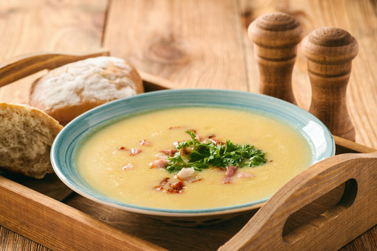 Potato cream soup with cheese and bacon.