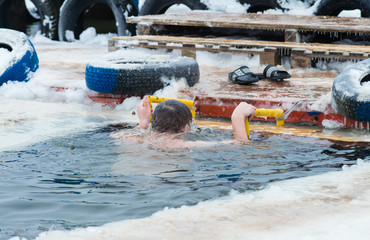 swimming in icy water, christening, baptism in Russia