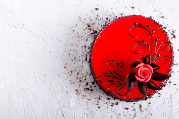 Red Cake with rose on white concrete background. Top view. Valentine's Day. Free space for your text.