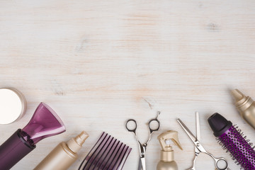Hairdresser tools on wooden background with copy space at top