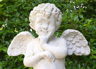 Cupid sculpture in the garden