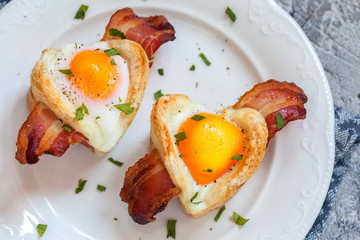 Baked egg breakfast with bacon heart shape for Valentine day