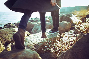 young couple, hipster outfit, fashion style, in love, woman and man,  sea on background, warm winter day, sunny. tenderness