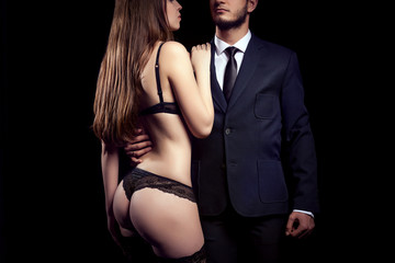 Hot woman in lingerie next to a businessman