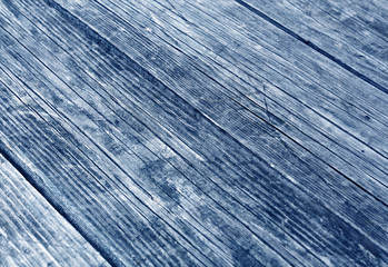 blue wooden surface with scratches and blur effect