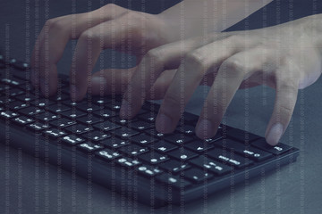 Hacker hands typing on computer keyboard