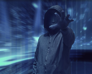 Hacker man with anonymous mask grabbing something