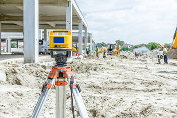 Modern device makes measurements with red laser level tool