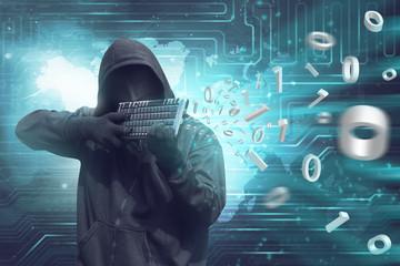 Man wearing vendetta mask holding keyboard to shooting