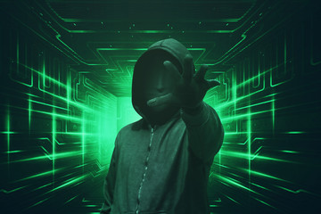 Hooded hacker with mask grabbing something