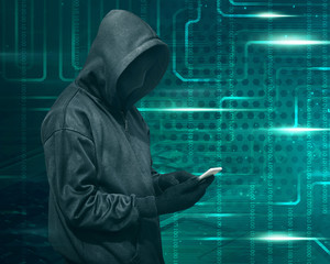 Hacker with mask touching a smartphone screen