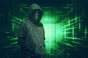 Hooded with anonymous mask standing with binary code