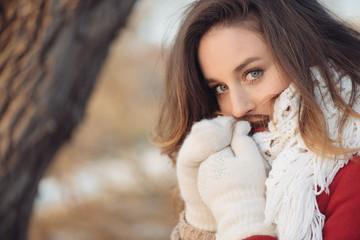 Beautiful cute brunette woman outdoor portrait.