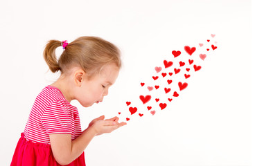 Little kid is sending heart shaped kisses
