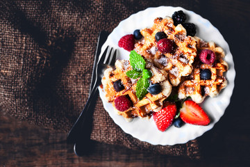 Delicious  Belgian waffles with mint leaf, strawberries and choc