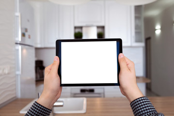 male hands holding tablet with isolated screen kitchen in house