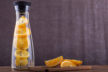 Refreshing water with orange . Orange slices a in  water. Drink