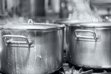 The big pot of boiling soup black and white photo
