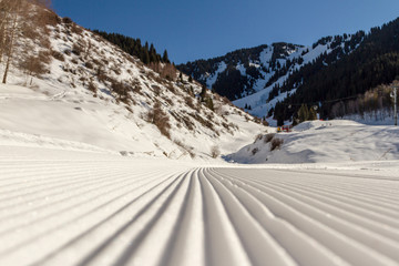waves from the snowcat on ski slopes