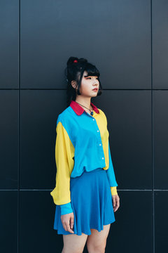 Young woman in colorful retro shirt and skirt