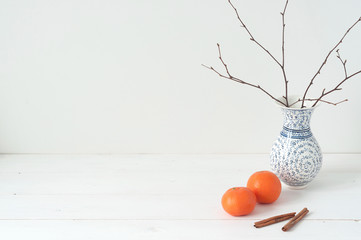 Minimal elegant composition with tangerines and vase
