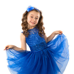 Portrait of a cute little girl in blue princess dress, isolated on white background