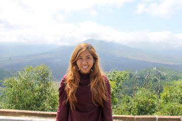 Southeast asian woman or posing in Mount Batur, Bali