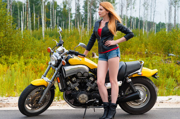 sexy woman with motorcycle on the road