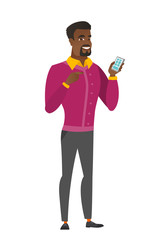 African business man holding a mobile phone.