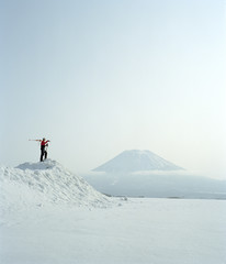 Man viewing snow covered volcano, Japan