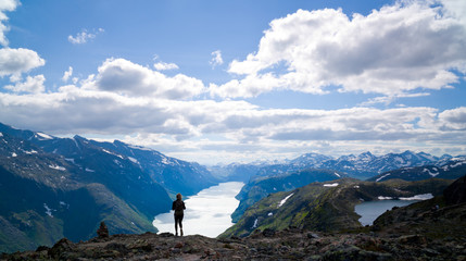 Young, blond woman hiking in Jotunheimen, Norway.