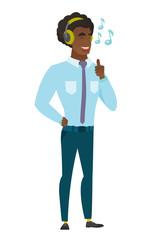 Businessman listening to music in headphones.