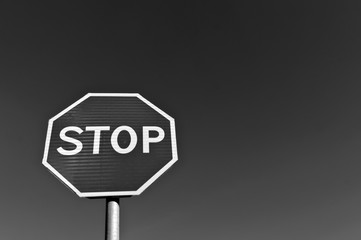 Stop sign in black and white.